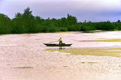 Fisherman alone in his boat at the river. stock photos