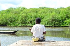 Fisherman on the amazonian river royalty free stock photography