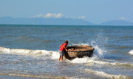Free Fisherman And His Traditional Round Boat (tung Chai). An Bang Beach. Hoi An. Vietnam Royalty Free Stock Images - 65853369