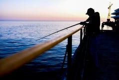 Fisherman angle at the berth stock image
