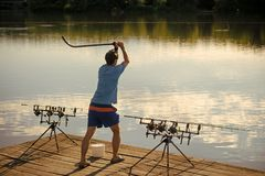 Fisherman attract fish with bait in river or lake Stock Image
