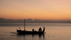 Fisherman in Bali at sunrise on his Jukung stock video footage