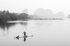 Fisherman on bamboo boat on the Li river Royalty Free Stock Photo