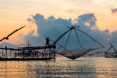 Fisherman on bamboo machinery in the morning Royalty Free Stock Photography