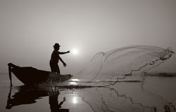 Fisherman of Bangpra Lake in action when fishing.(Sepia Style) Stock Photos