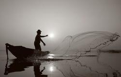 Fisherman of Bangpra Lake in action when fishing.(Sepia Style) Stock Photos