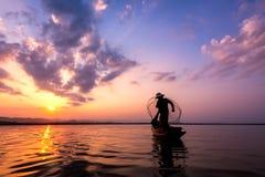 Fisherman of Bangpra Lake royalty free stock image