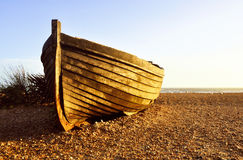 Fisherman barque at sunset. On Brighton beach, UK stock photography