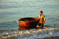 Fisherman with basket boat in Vietnam Royalty Free Stock Photo