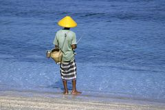 Fisherman on the beach Royalty Free Stock Image