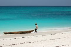 Fisherman on the beach. In Zanzibar, Tanzania royalty free stock photography