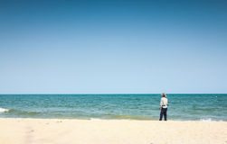 Fisherman on beach. And blue sky in southern part Royalty Free Stock Photos