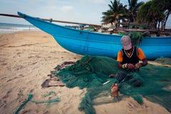Fisherman on beach, Colombo, Sri Lanka Stock Photography