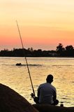 Fisherman on the beach Royalty Free Stock Photo