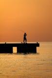 Fisherman on beach Stock Image