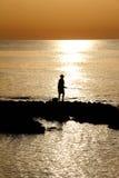 Fisherman on beach Stock Photos