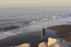 Fisherman on the beach of Malaga Spain royalty free stock photos