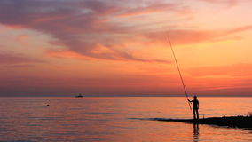 Fisherman on the Beach stock video footage