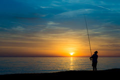 Fisherman on the beach Stock Images