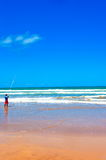 Fisherman at the beach Stock Photography