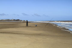 Fisherman on the beach in uk. Blue clean sky Stock Images