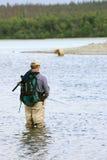 Fisherman and bear Stock Photos