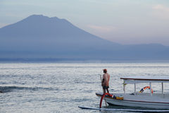 Fisherman and Beautiful Mountain Royalty Free Stock Photos
