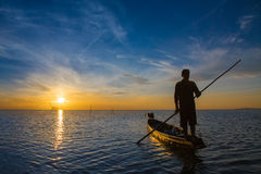 Fisherman with beautiful sunrise Stock Photo
