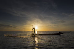 Fisherman with beautiful sunrise Stock Images
