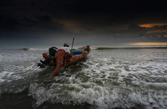 Fisherman begin journey to catch fish Stock Images