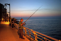 Fisherman, Beirut seafront. A fisherman at night, Beirut seafront Stock Photo