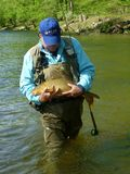 Fisherman With Big Carp Royalty Free Stock Images