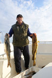 Fisherman with big fish. On the boat Stock Photos