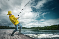 Fisherman. With an big fish at the hinge Royalty Free Stock Photography