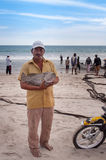 Fisherman with big fish on Tiku beach Stock Image