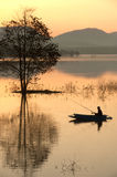 Fisherman on big lake in morning . Royalty Free Stock Photography
