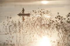 Fisherman on big lake in morning . Royalty Free Stock Images