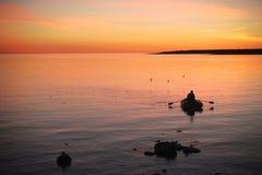 Fisherman and birds. Fisherman preparing for night fishing, Solovetsky Islands, Islandterns Royalty Free Stock Photography