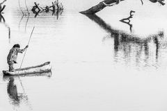 Fisherman in black and white. A fisherman in the luangwa river Stock Photos