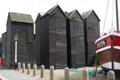 Fisherman black wooden huts at Hastings, England Royalty Free Stock Images