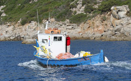 The fisherman on blue Royalty Free Stock Photography