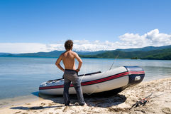 Fisherman by boat Stock Photos