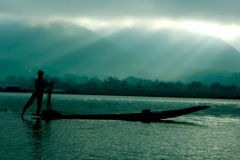 Fisherman in boat. Silhouette of fisherman in boat Royalty Free Stock Photo