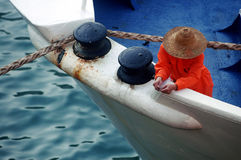 Fisherman on the boat Stock Photos
