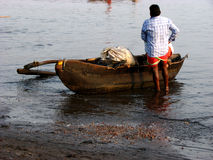 Fisherman Boat. An Indian fisherman all set to go for fishing in the sea in his boat Stock Photo