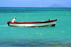 Fisherman in a boat stock image
