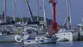 Fisherman boat arriving in the harbor stock video