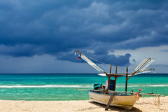 The fisherman boat on the beach Royalty Free Stock Photography