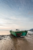 Fisherman boat at the beach during dramatic sunset Royalty Free Stock Image