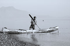 Fisherman in a boat Stock Images
